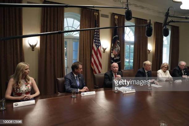US President Donald Trump center speaks during a meeting with members of Congress in the Cabinet Room of the White House in Washington DC US on...