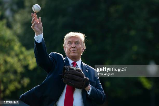 President Donald Trump throws a baseball on the South Lawn of the White House on July 23, 2020 in Washington, DC. President Trump and former New York...