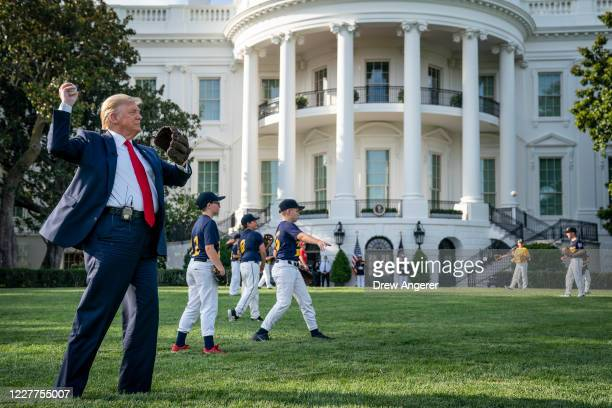 S President Donald Trump throws a baseball on the South Lawn of the White House on July 23 2020 in Washington DC President Trump and former New York...