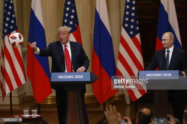 S President Donald Trump throws a soccer ball Russian President Vladimir Putin gave him during a joint press conference after their summit on July 16...