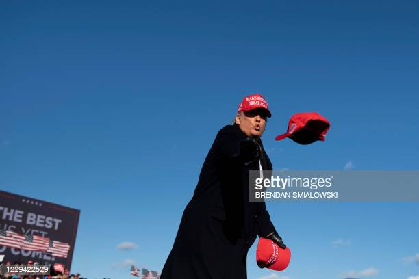 President Donald Trump throws hats to supporters during a Make America Great Again rally at Wilkes-Barre Scranton International Airport November 2 in...