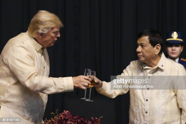 US President Donald Trump toasts with Philippines President Rodrigo Duterte during a special gala celebration dinner for the Association of Southeast...