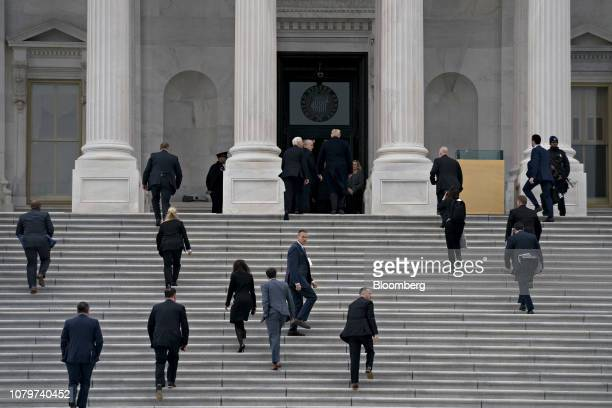 US President Donald Trump top center right and US Vice President Mike Pence top center left arrive to the US Capitol for a meeting with Senate...