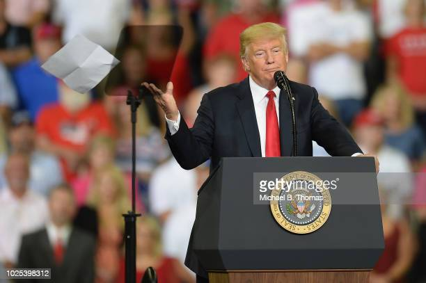 S President Donald Trump tosses a report during his speech at a campaign rally at the Ford Center on August 30 2018 in Evansville Indiana The...