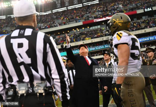 US President Donald Trump tosses the coin before the Army v Navy American Football game in Philadelphia on December 14 2019