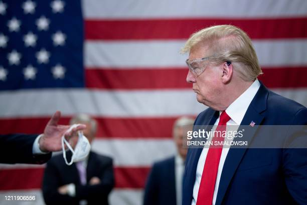 President Donald Trump tours a Honeywell International Inc. Factory producing N95 masks during his first trip since widespread COVID-19 related...