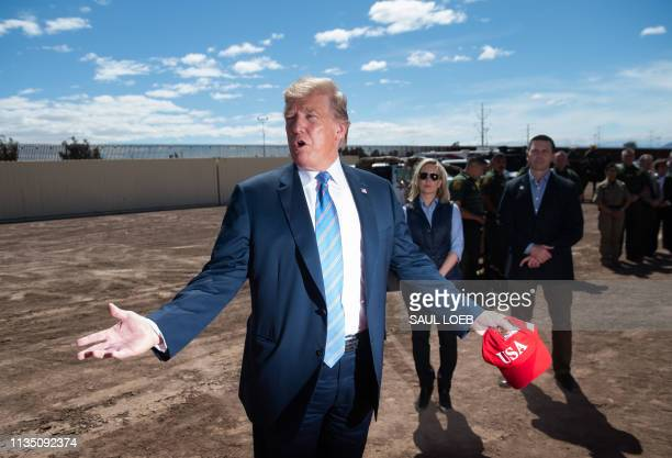 US President Donald Trump tours the border wall between the United States and Mexico in Calexico California April 5 2019 President Donald Trump...