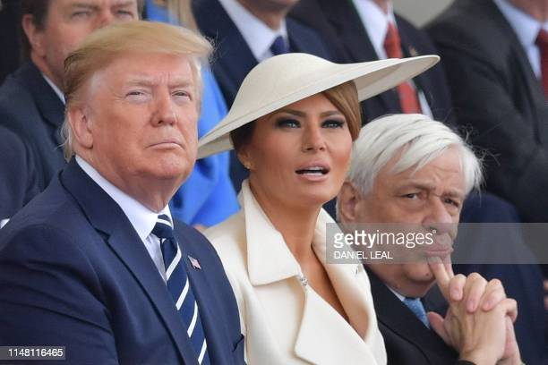 US President Donald Trump US First Lady Melania Trump and Greek President Prokopis Pavlopoulos look up as aircraft perform a flyover during an event...