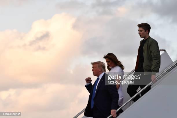 US President Donald Trump US First Lady Melania Trump and son Barron Trump arrive at Palm Beach International Airport in West Palm Beach Florida...