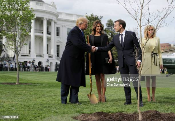 S President Donald Trump US first lady Melania Trump French President Emmanuel Macron and his wife Brigitte Macron participate in a treeplanting...