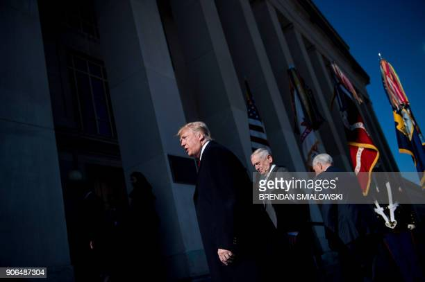 US President Donald Trump US Secretary of Defense James Mattis and US Vice President Mike Pence walk into the Pentagon for a meeting January 18 2018...
