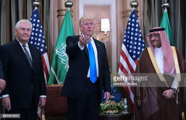 US President Donald Trump US Secretary of State Rex Tillerson and Saudi Crown Prince Muhammad bin Nayif bin Abdulaziz alSaud take part in a bilateral...