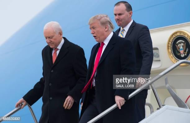 US President Donald Trump US Senator Orrin Hatch Republican of Utah and US Senator Mike Lee Republican of Utah as they disembark from Air Force One...