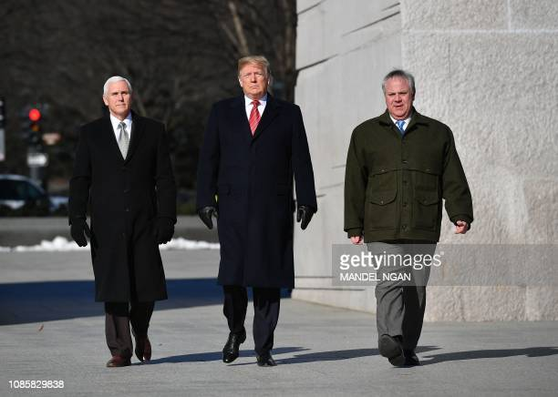 US President Donald Trump Vice President Mike Pence and acting Interior Secretary David Bernhardt visit the Martin Luther King Jr Memorial in...