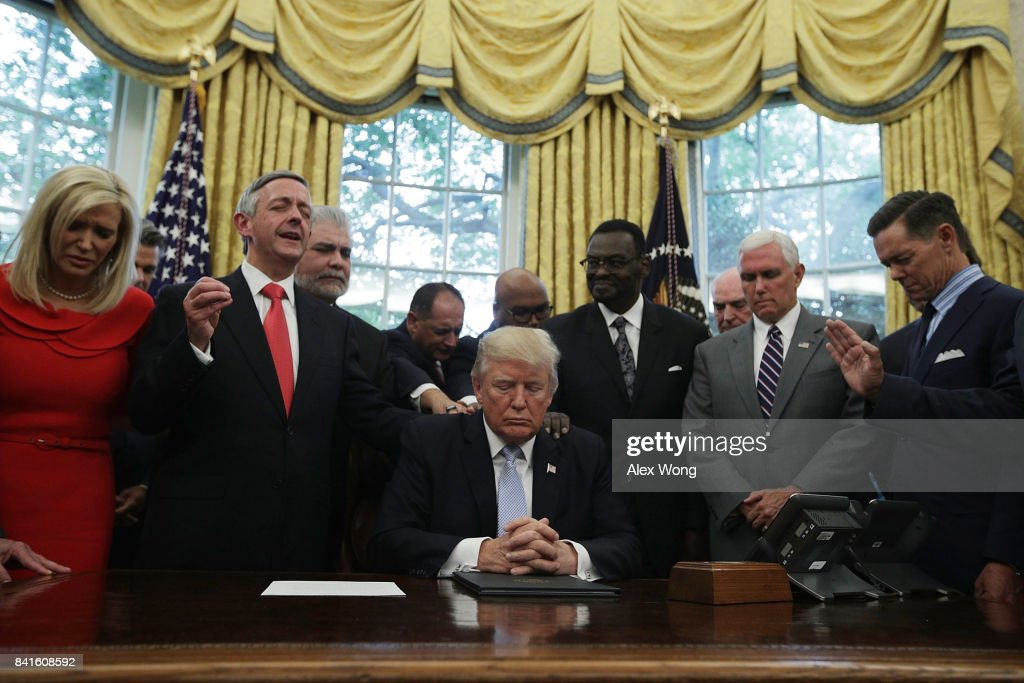 President Trump Signs Proclamation Declaring Sunday Day Of Prayer For Victims Of Hurricane Harvery : News Photo