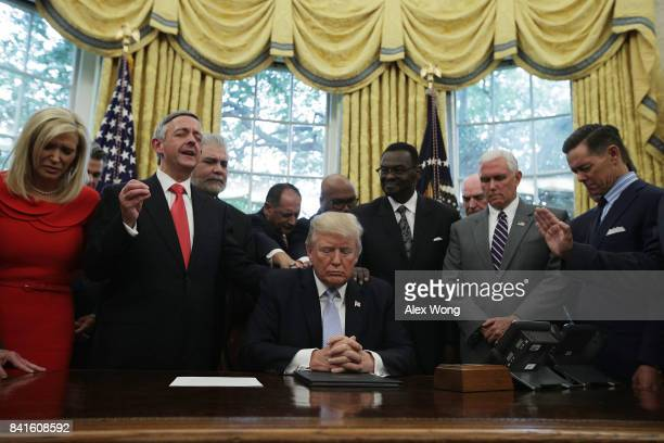S President Donald Trump Vice President Mike Pence and faith leaders say a prayer during the signing of a proclamation in the Oval Office of the...
