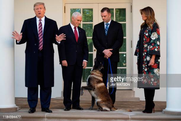President Donald Trump , Vice President Mike Pence and First Lady Melania Trump stand with Conan, the military dog that was involved with the death...