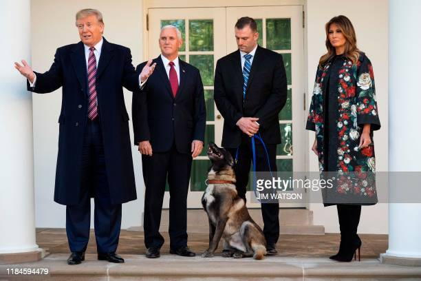 US President Donald Trump Vice President Mike Pence and First Lady Melania Trump stand with Conan the military dog that was involved with the death...