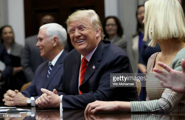 S President Donald Trump Vice President Mike Pence and Ivanka Trump listen during a conference call with the International Space Station on October...