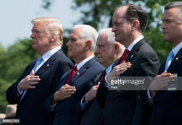 President Donald Trump Vice President Mike Pence Attorney General Jeff Sessions and Health and Human Services Secretary Alex Azar stand for the...