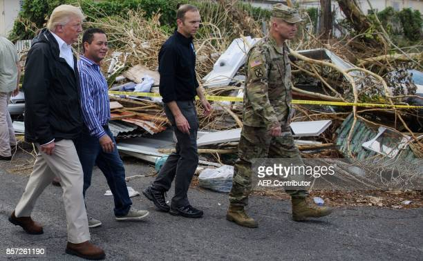 President Donald Trump visits residents affected by Hurricane in Guaynabo west of San Juan Puerto Rico on October 3 2017 Nearly two weeks after...