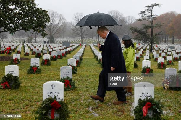 S President Donald Trump visits Section 60 at Arlington National Cemetery on December 15 2018 in Arlington Virginia Trump is visiting the cemetery...