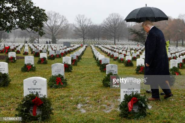 President Donald Trump visits Section 60 at Arlington National Cemetery on December 15, 2018 in Arlington, Virginia. Trump is visiting the cemetery...