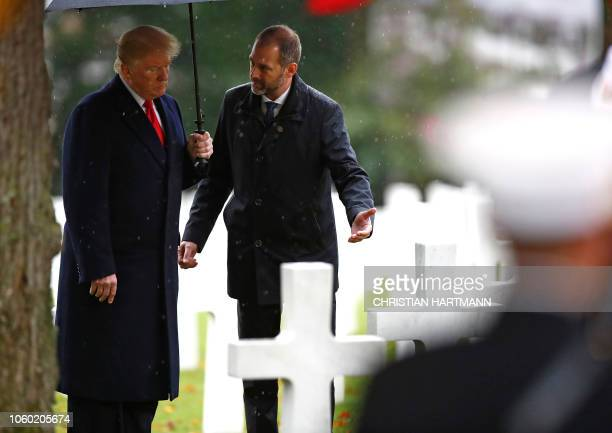 US President Donald Trump visits the American Cemetery of Suresnes outside Paris on November 11 2018 as part of Veterans Day and commemorations...