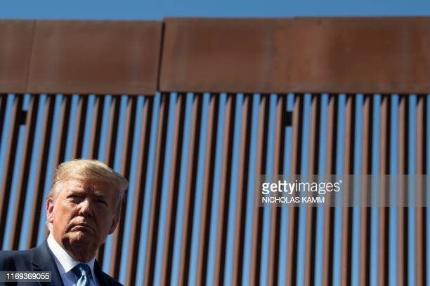 President Donald Trump visits the US-Mexico border fence in Otay Mesa, California on September 18, 2019.