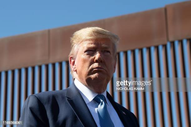 President Donald Trump visits the USMexico border fence in Otay Mesa California on September 18 2019