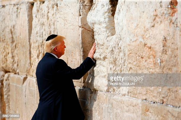 US President Donald Trump visits the Western Wall the holiest site where Jews can pray in Jerusalems Old City on May 22 2017 ZVULUN