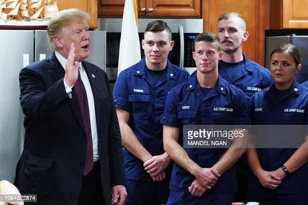US President Donald Trump visits with personnel at US Coast Guard Station Lake Worth Inlet in Riviera Beach Florida on Thanksgiving Day November 22...