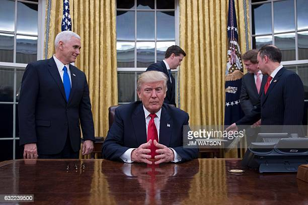 US President Donald Trump waits at his desk before signing confirmations for James Mattis as US Secretary of Defense and John Kelly as US Secretary...