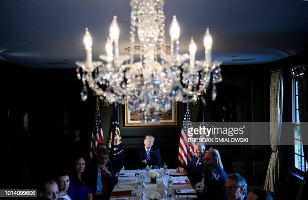 President Donald Trump waits for a meeting with administration and state officials on prison reform at the Trump National Golf Club August 9 2018 in...