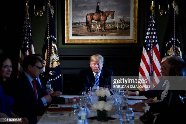 US President Donald Trump waits for a meeting with administration and state officials on prison reform at the Trump National Golf Club August 9 2018...