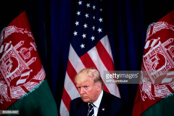 US President Donald Trump waits for a meeting with Afghanistan's President Ashraf Ghani at the Palace Hotel during the 72nd United Nations General...
