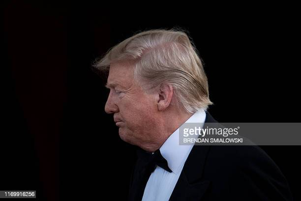 President Donald Trump waits for Australian Prime Minister Scott Morrison and his wife Jennifer Morrison for an Official Visit with a Official Visit...