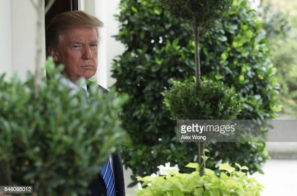 S President Donald Trump waits for the arrival of Prime Minister Najib Abdul Razak of Malaysia outside the West Wing of the White House September 12...