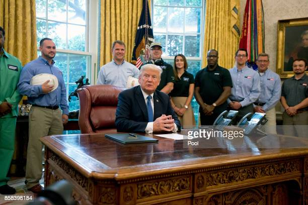 US President Donald Trump waits for the press pool to settle before signing a National Manufacturing Day Proclamation in the Oval Office of the White...