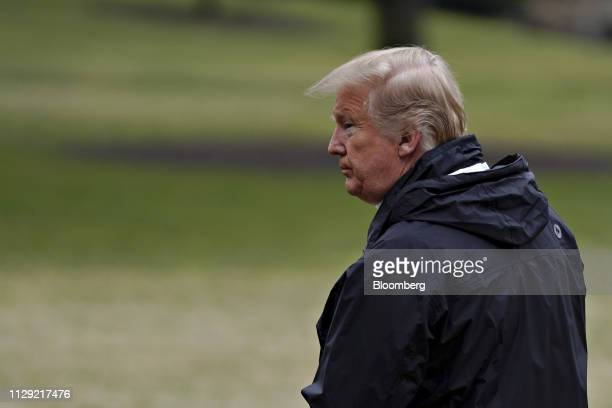 US President Donald Trump waits for US First Lady Melania Trump and son Barron Trump not pictured on the South Lawn of the White House before...