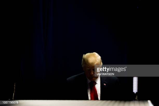 US President Donald Trump waits off stage to be introduced to deliver remarks at a Make America Great Again rally in Fort Wayne Indiana on November 5...