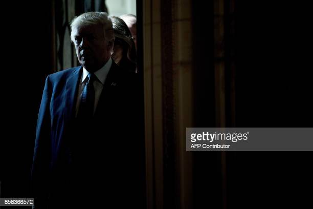 US President Donald Trump waits to enter for a Hispanic Heritage Month event in the East Room of the White House October 6 2017 in Washington DC...