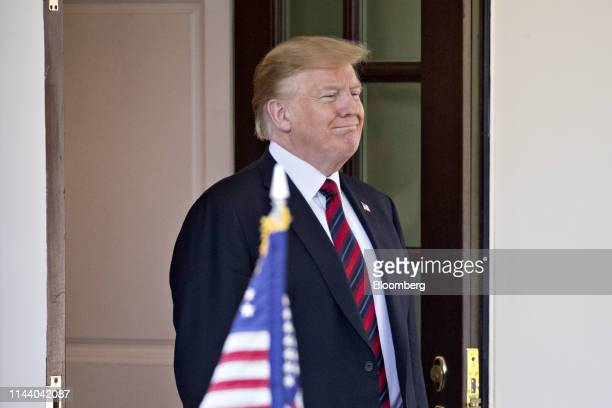 US President Donald Trump waits to greet Ueli Maurer Switzerland's finance minister not pictured at the West Wing of the White House in Washington DC...