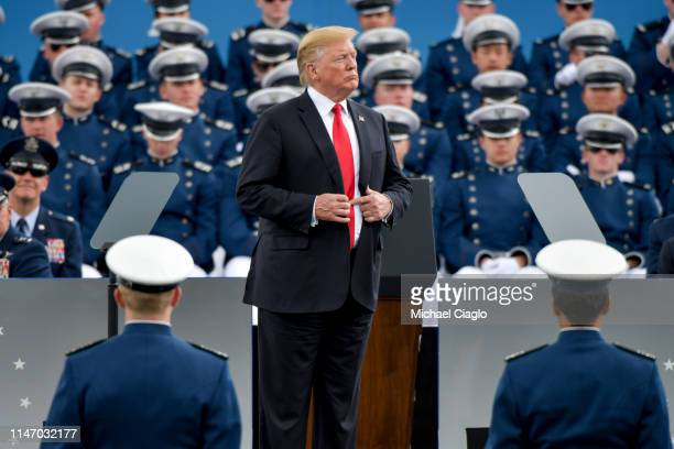 President Donald Trump waits to shake hands with United States Air Force Academy cadets as they receive their diplomas during their graduation...