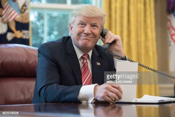 US President Donald Trump waits to speak on the phone with Irish Prime Minister Leo Varadkar to congratulate him on his recent election victory in...
