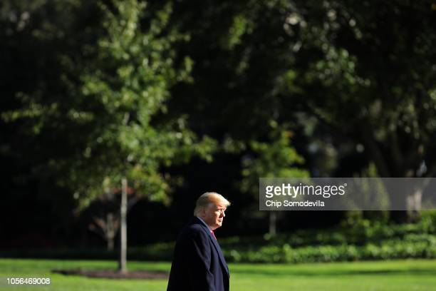 S President Donald Trump walks across the South Lawn before boarding Marine One and departing the White House October 18 2018 in Washington DC Trump...
