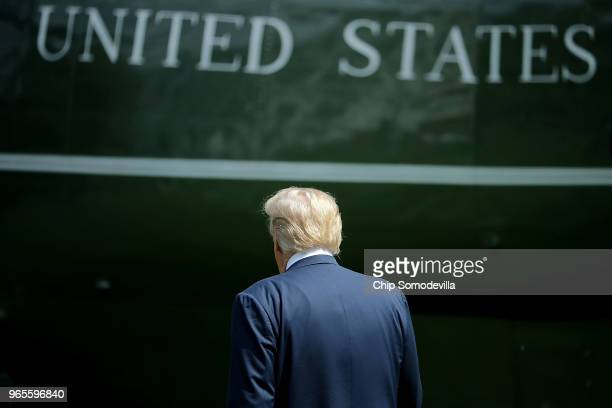 S President Donald Trump walks across the South Lawn before boarding Marine One and departing the White House June 1 2018 in Washington DC Trump is...
