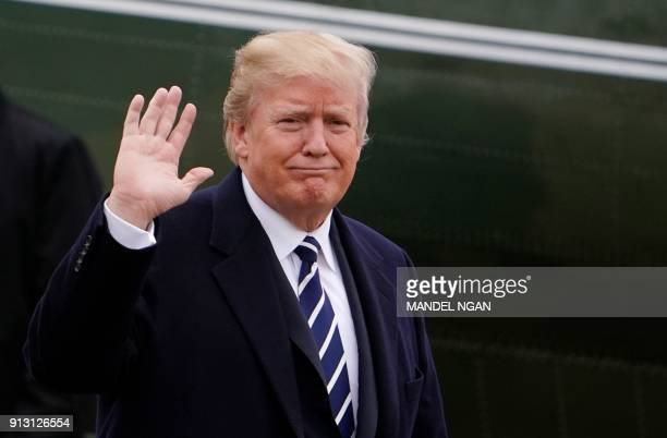 US President Donald Trump walks across the South Lawn upon return to the White House on February 1 2018 in Washington DC after addressing the 2018...