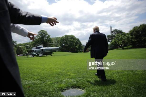 S President Donald Trump walks across the South Lawn while departing the White House May 23 2018 in Washington DC Trump is traveling to New York...