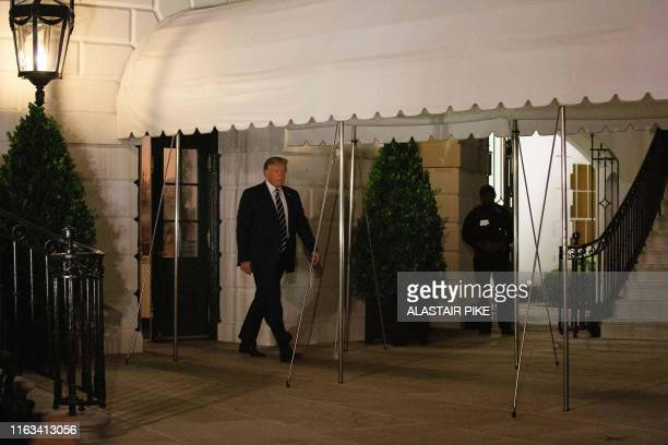 US President Donald Trump walks as he departs the White House in Washington DC on August 23 for the G7 Summit in France